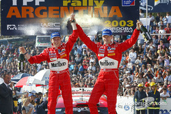 The podium: winners Marcus Gronholm and Timo Rautiainen celebrate
