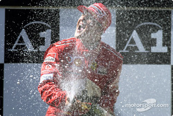 The podium: champagne for Michael Schumacher