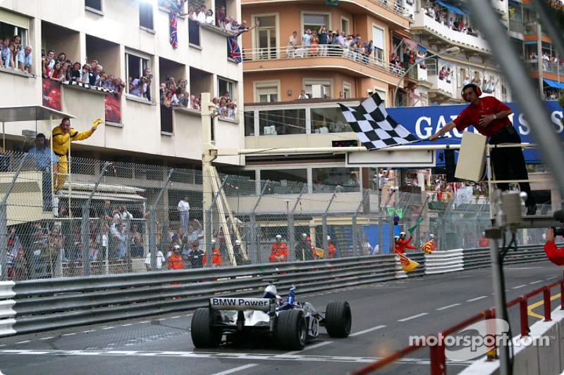 Juan Pablo Montoya takes the checkered flag