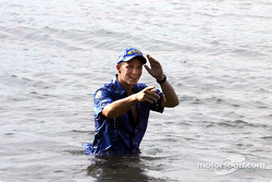 Petter Solberg cools off in the sea before the start