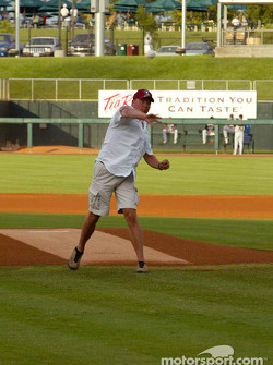 J.J. Lehto of the ADT Champion Audi team throws out the first pitch before the Sacramento River Cats game on Tuesday night