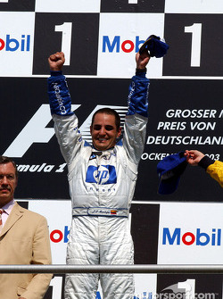 The podium: race winner Juan Pablo Montoya