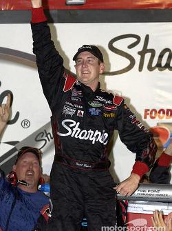 Race winner Kurt Busch celebrates on victory lane