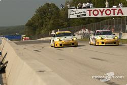 #24 Alex Job Racing Porsche 911 GT3 RS: Timo Bernhard, Jorg Bergmeister, and #23 Alex Job Racing Porsche 911 GT3 RS: Lucas Luhr, Sascha Maassen