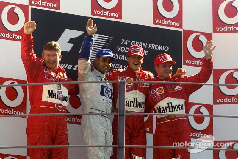 Podio: ganador de la carrera Michael Schumacher, segundo lugar  Juan Pablo Montoya y tercer lugar Rubens Barrichello y Ross Brawn