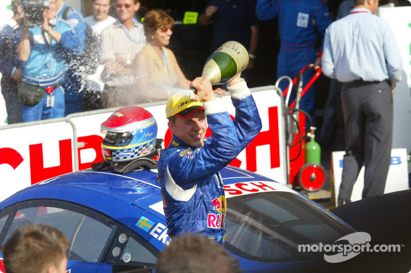 Mattias Ekström celebrates third place finish