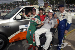 Cody Unser and Mark Buonaconte with race winner Mario Dominguez, Roberto Moreno and Mika Salo