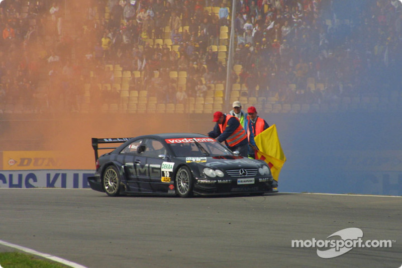 Race winner Jean Alesi celebrates