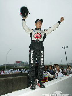 Takuma Sato celebrates sixth place finish