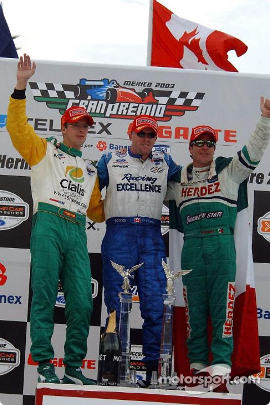 Podium : Paul Tracy, vainqueur, avec Sébastien Bourdais et Mario Dominguez