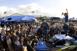 Winner Petter Solberg celebrates victory