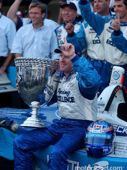 Podium: 2003 Champ Car champion Paul Tracy celebrates with his team