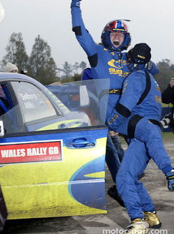 Tommi 'Golden boots' Makinen celebrates with Petter Solberg