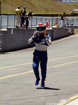 Craig Lowndes runs back to the pits after the shoot out