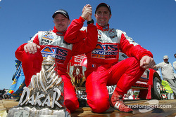 Overall winner Stéphane Peterhansel and Jean-Paul Cottret celebrate
