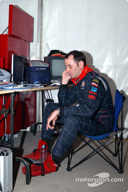 Matthew White takes a break between races to talk to a friend on the mobile