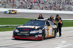 Joe Nemechek's crew pushes him back to the garage area