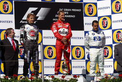 Podium: race winner Michael Schumacher with Jenson Button and Juan Pablo Montoya