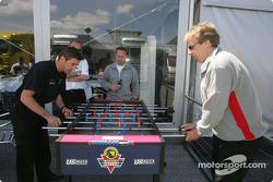 Bernd Schneider and Frank Biela play table football