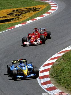 Jarno Trulli leads Michael Schumacher
