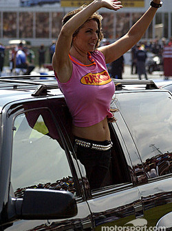 Race girl waves at the fans