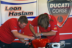 Crew works on the Ducati of Leon Haslam
