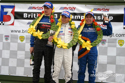 Podium: race winner Adam Carroll with James Rossiter and Will Power