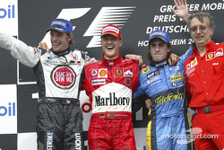 Podium: race winner Michael Schumacher with Jenson Button, Fernando Alonso and Paolo Martinelli
