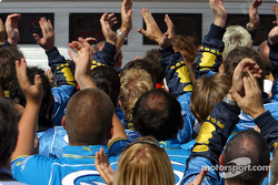 Renault F1 team members celebrate podium finish