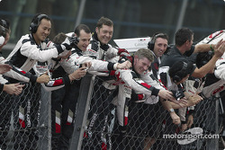 BAR-Honda team members celebrate third place finish of Jenson Button