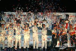 GT podium: class winners Timo Bernhard, Jorg Bergmeister, Sasha Maassen, with Marc Lieb, Romain Dumas, Wolf Henzler, and Craig Stanton, David Murry, Michael Petersen