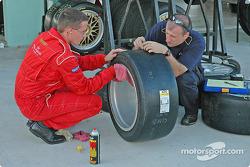 Crew members prepare wheels