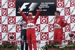 Podium: race winner Michael Schumacher celebrates