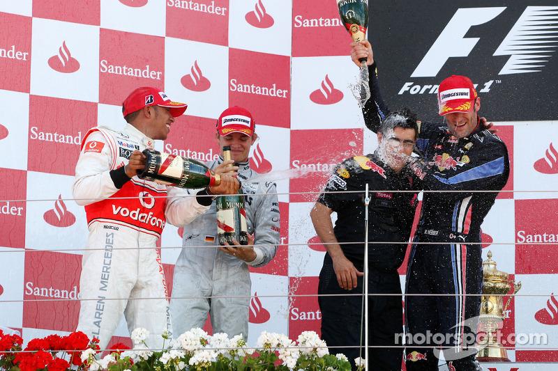 Podium: race winnaar Mark Webber, Red Bull Racing, 2de Lewis Hamilton, McLaren Mercedes, 3de Nico Ro