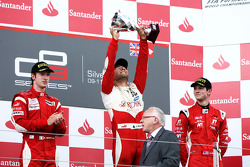 Daniel Morad celebrates victory on the podium with Mirko Bortolotti and Alexander Rossi