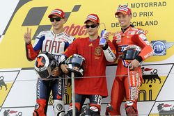 Podium: race winner Dani Pedrosa, Repsol Honda Team, second place Jorge Lorenzo, Fiat Yamaha Team, third place Casey Stoner, Ducati Marlboro Team