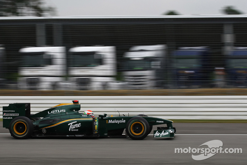 Jarno Trulli, Lotus F1 Team passing lorries that would normally be in the paddock