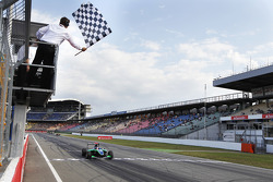 Robert Wickens celebrates victory as he takes the chequered flag