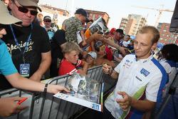 Mikko Hirvonen signs autographs