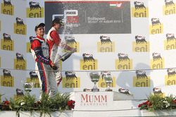 Nico Muller celebrates victory on the podium with Esteban Gutierrez