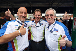 Senior Ford of Europe Management, Gerard Quinn and Ian Slater join in the celebrations with Malcolm Wilson after BP Ford Abu Dhabi World Rally Team driver Jari-Matti Latvala's win