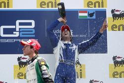 Giacomo Ricci celebrates his victory on the podium with Christian Vietoris