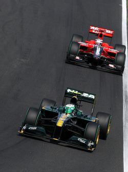 Heikki Kovalainen, Lotus F1 Team rijdt voor Timo Glock, Virgin Racing
