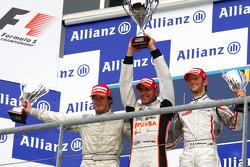 Podium: race winner Pastor Maldonado, second place Alvaro Parente, third place Romain Grosjean