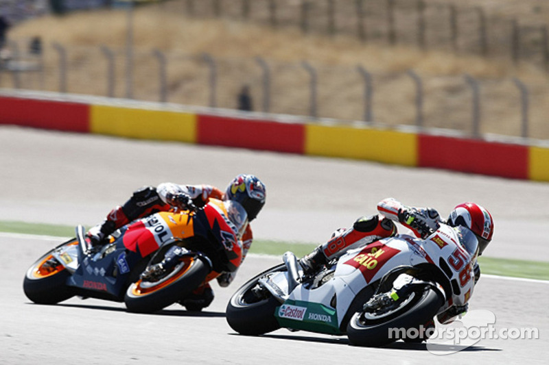 Марко Сімончеллі, San Carlo Honda Gresini, Андреа Довіціозо, Repsol Honda Team