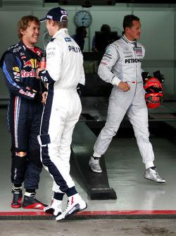 Sebastian Vettel, Red Bull Racing, pole winner Nico Hulkenberg, Williams F1 Team and Michael Schumacher, Mercedes GP