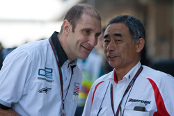 Bruno Michel GP2 Series Organiser talks with Hiroshi Yasukawa, Director of Bridgestone Motorsport