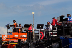 Team members watch final practice from atop their haulers