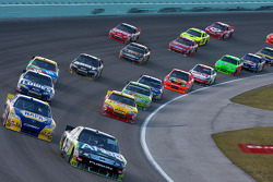 Carl Edwards, Roush Fenway Racing Ford leads Martin Truex Jr., Michael Waltrip Racing Toyota