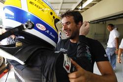 Race winner Enrique Bernoldi celebrates with Michael Bartels